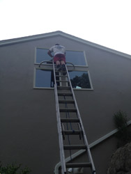Washing window on high ladder